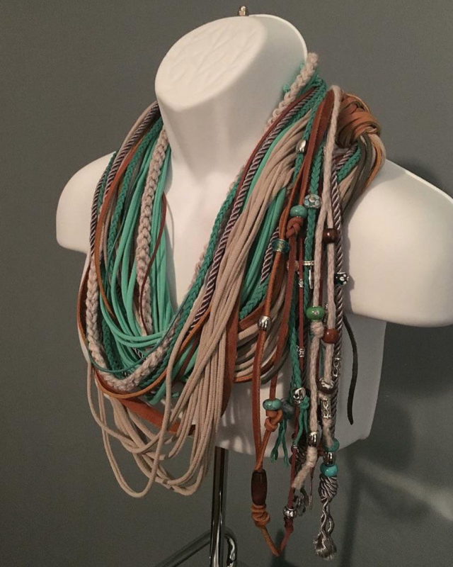 Implexa Scarf - Latin for Entwined, I created Implexa several years ago playing with recycled t-shirts. My mind exploded when I started adding different elements such as leather, suede, cords, beads, and charms. Soon I realized I had more than just a simple scarf... it's also a piece of jewelry. Implexa was designed to be worn any time of the year. Choose up to three different colors.  (Brown or black as the leather choice). Allow me to design this one of a kind piece.